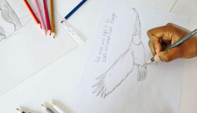 Lady hand drawing an eagle with a bible verse for custom designed corporate greeting cards for bulk business orders