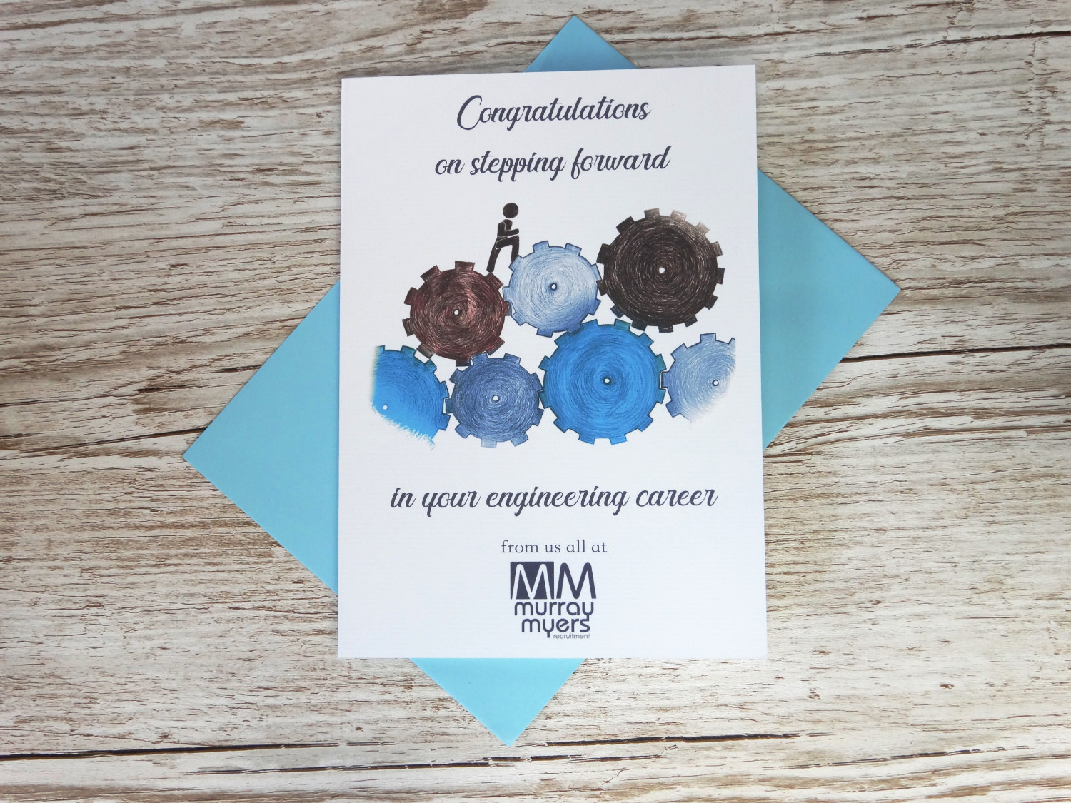 Custom corporate congratulations on your new job card for businesses with bespoke hand drawn blue cogwheels and logo in bulk